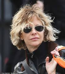meg ryan s hairstyles over the years meg ryan s blonde hair is blasted by a gust of wind as she shops