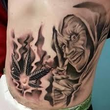 black and grey ink marijuana leaf goblin tattoo on side rib