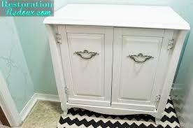 vintage cabinet turned laundry hamper restoration redoux
