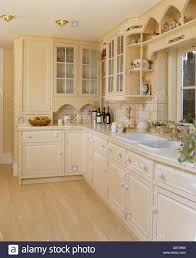 Distressed Laminate Flooring Pale Neutral Kitchen With Distressed Paint On Cupboard Doors And