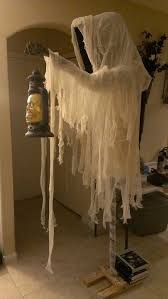 halloween string lights and netting page one halloween wikii 2014 cloaked halloween ghost with skull lantern cheesecloth