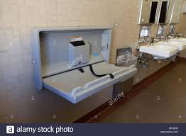 Foldable Change Table Folding Baby Changing Table In Restroom Usa Stock Photo