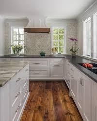 white shaker kitchen cabinets wood floors rustic wood floors complement inset white shaker cabinets