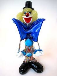 the murano glass clown stands holding a black violin in white
