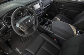 nissan titan steering wheel nissan titan and frontier get midnight editions look stealthy