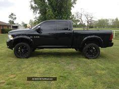 dodge ram with black rims lifted jacjed black dodge ram truck oversize tires dodge trucks