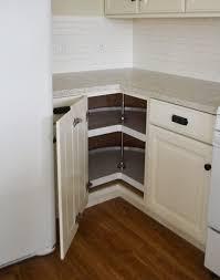 kitchen corner cabinet hinge adjustment installing pie cut hinged doors for lazy susan corner