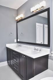 3 stylish modern bathroom lighting fixtures over mirror home of