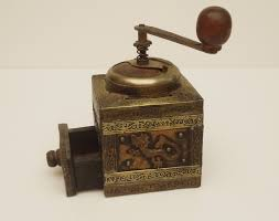 vintage wooden coffee mill with openwork and engraved brass