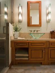 floating vanity with vessel sink rectangle brown wooden frame wall miror above green glass vessel