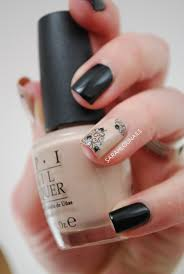 opi black and beige nail art with design on ring finger a must