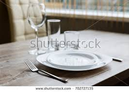 water glasses on table setting table setting two white plates one stock photo royalty free