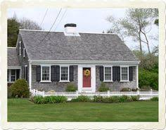love the modern country cottage feel of this sweet home exterior