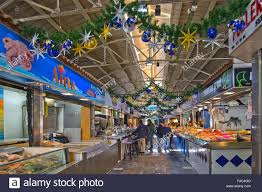 santa catalina market in christmas decor and people shopping on