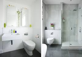 white bathrooms with dark floors this lengthy white bathroom