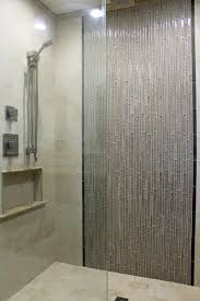 master shower design beige wall tile with gray glass mosaic