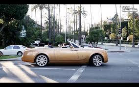 rolls royce gold shiny bling gold rolls royce distracts driving causing him crash
