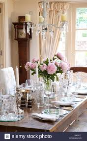 Glass Chandeliers For Dining Room Glass Chandelier Above Table Set For Lunch With Vase Of Pink