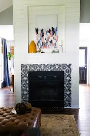 a fireplace makeover using shiplap and patterned tiles