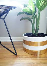 thrift store diy home decor spray painting planter with simple stripes hometalk