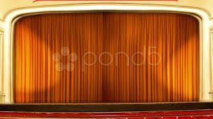 stock video theater curtains opening orange 12573369