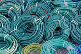 big bunch of green garden hose coils stock photo picture and