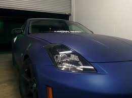 Nissan 350z Blacked Out - back with blacked out headlights nice touch with carbon fiber