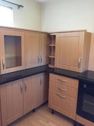 lovely beech kitchen with black high gloss worktops complete with