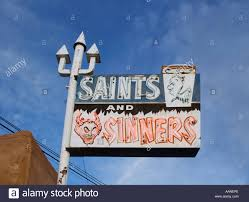 Liquor Signs by Saints And Sinners Sign At A Liquor Store In Espanola New Mexico