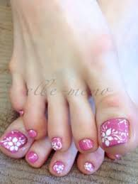 pink and white pedicure with glitter and gems toe nail art