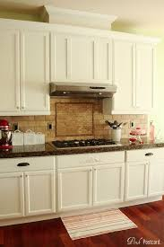 wood kitchen cabinets painted white remodelaholic wood kitchen cabinets updated to white