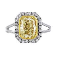 canary yellow engagement ring cushion cut fancy yellow engagement ring in 18k two tone gold