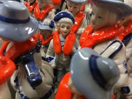 artist clads vintage porcelain figurines in life jackets to