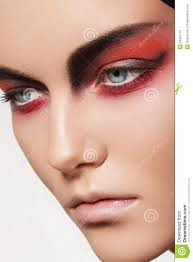 fashion model face with devil halloween make up royalty free stock