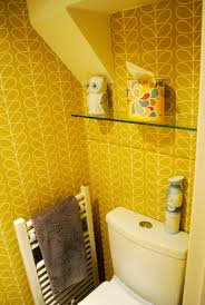 downstairs bathroom makeover featuring orla kiely wallpaper