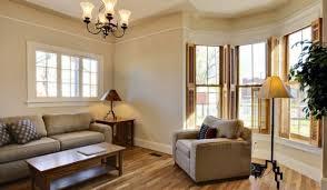 beautiful bay window living room decorating beige striped fabric
