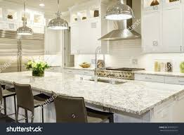 white kitchen design features large bar stock photo 555797371