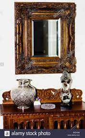 Mirror In Living Room Showpieces On A Chest With Mirror In A Living Room Stock Photo