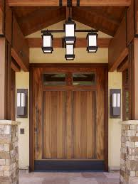 high end home entry craftsman with outdoor lighting double front
