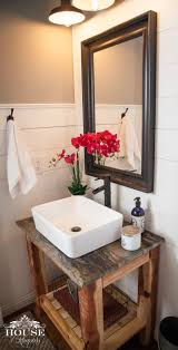 farmhouse bathroom with shiplap walls floating wood slab vanity