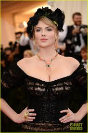 floral headdress kate upton wears black floral headdress shows lots of cleavage at
