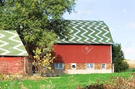 red barn with striped green roof stock photo picture and royalty
