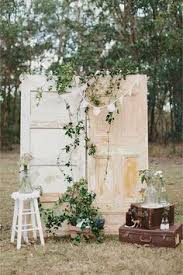 wedding arch using doors a clever way to use doors and dried flowers to create a rustic
