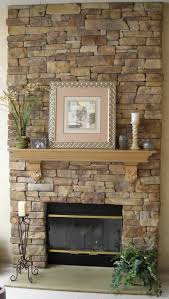interior stacked grey stone fireplace with black fire box and