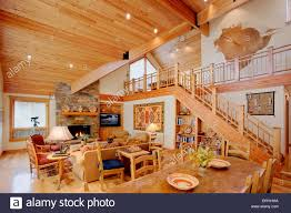 the interior of a modern log cabin depicting luxury amid a rustic