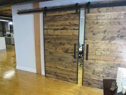 Steel Barn Door by Handmade Industrial Reclaimed Barn Doors On Steel Track By The