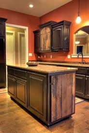 antiqued cypress cabinets and black distressed island