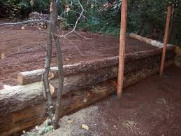 Backyard Retaining Walls Ideas by Vertical Log Retaining Wall Google Search Yard And Outdoor