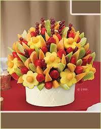 cheap fruit arrangements papatyalar sulu papatya ananaslar kantalup kavunu ve üzümlerle