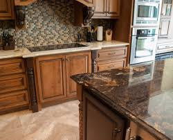 brick backsplash in kitchen granite countertop lights in kitchen cabinets painted brick